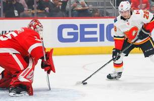 red wings drop sixth straight, 5-3 to flames