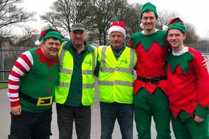 group of elves visit west lothian foodbank to make food donations