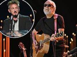 Cat Stevens 'was almost not permitted' into the U.S. for Sean Penn's charitable gala for Haiti