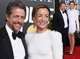 golden globes: hugh grant's wife anna eberstein steals focus in a leggy white mini-dress
