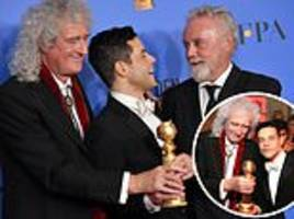 golden globes: queen's brian may and roger taylor beam as they pose with rami malek