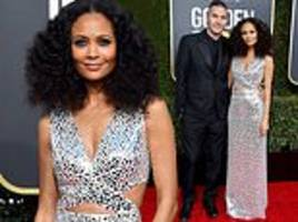 golden globes: thandie newton wows in an ab-baring silver gown as she cosies up to husband ol parker