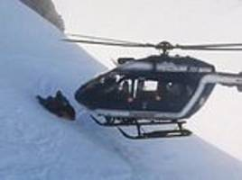 skilful helicopter pilot lands on mountainside in french alps to rescue injured mountaineer