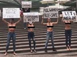 group of 'secret sisters' host a topless protest in sydney's martin place