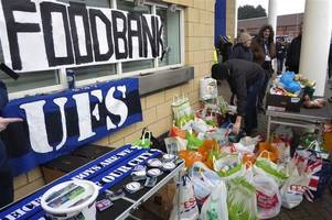 leicester city fc supporters group sets up foodbank outside the king power stadium