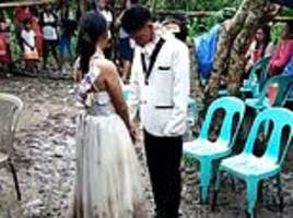newlyweds have an awkward first dance ankle-deep in mud 24 hours after typhoon hits the philippines