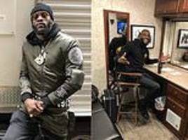 deontay wilder poses in front of trailer as he awaits acting debut