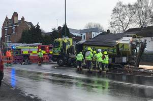 dramatic pictures show cement mixer which has crashed down a manhole in sneinton