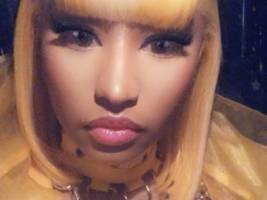nicki minaj finds her inner iggy azalea down under