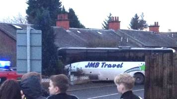 School bus crashes into Coatbridge house