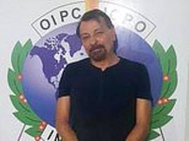 italian far-left militant arrested 'disguised in a fake beard' while on the run in bolivia