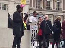 john mcdonnell is accused of failing to condemn activist's call for theresa may 'to shoot herself'
