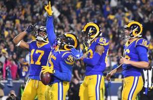 anderson, gurley dominate cowboys as rams get first playoff win in 14 years