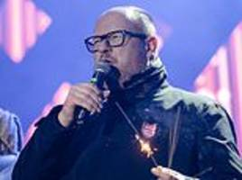 popular polish mayor fights for life after being stabbed on stage