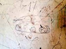 remarkable doodles and graffiti british troops left in normandy barn just after d-day