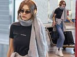 gigi hadid looks effortlessly stylish in cropped jeans as she steps out during milan fashion week