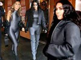 Kim Kardashian copies BFF Larsa Pippen's look as she sports clinging grey catsuit on rainy day in LA