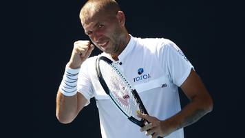 britain's evans wins first slam match since drugs ban
