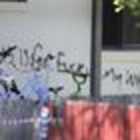 outrageous graffiti on wall of gold coast house gutted by fire