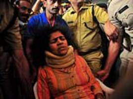 Woman who defied mob to enter Indian temple is beaten up by her mother-in-law as she returns home