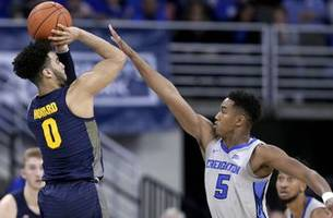 statuesday: marquette's howard making case as one of top shooters in past decade