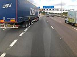 driver is forced to swerve onto the hard shoulder after a lorry suddenly turns into speeding traffic