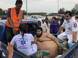 rescuers haul obese 50-stone man from hut ahead of treatment for breathing problems