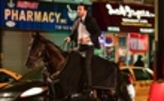 keanu reeves rides a horse through nyc in 'john wick: chapter 3 - parabellum' trailer