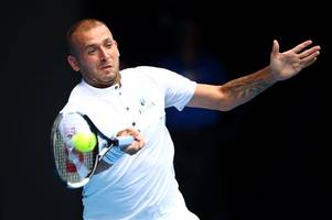 dan evans bounces back to test roger federer after 'dark days' during ban at home in cheltenham