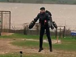 Royal Marine sets new assault course record as jet pack allows him to zoom over the obstacles