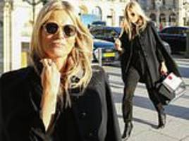 Kate Moss continues her Parisian fashion parade in chic black cape as she indulges in a sightseeing