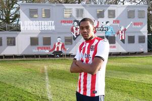 exeter city sign huddersfield town defender on loan