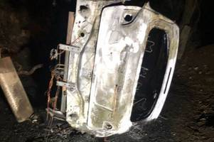 firefighters tackle blaze after car overturns and catches fire in lostwithiel