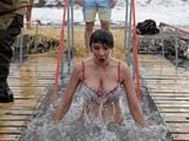 Russian Orthodox Christians take dips in icy water for Epiphany celebrations