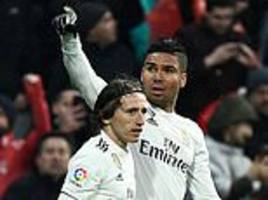 thunderbolt from casemiro and a late luka modric strike eases santiago solari's side past sevilla