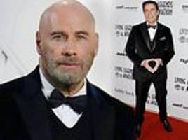 john travolta continues to showcase his newly shaved head at living legends of aviation awards