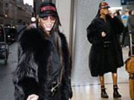 Winnie Harlow looks fashionable in a furry jacket as she struts her stuff at Roissy CDG airport