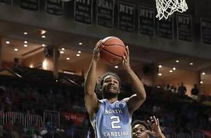Johnson scores 22 to help No. 13 Tar Heels beat Miami 85-76