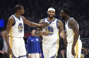 Boogie Cousins overcomes nerves in 1st game with Warriors