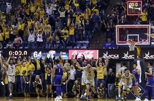 jayhawks collapse late, fall 65-64 to mountaineers