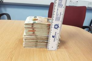 police find £10,000 in cash under the stairs as officials claim some small shops are just fronts for illegal tobacco trade