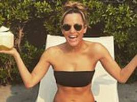 caroline flack, 39, poses in a black bikini and says she's 'grateful' for a 'tiny bit of healing'