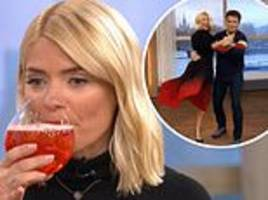 Holly Willoughby giggles after drinking Aperol Spritz and dancing with John Barrowman