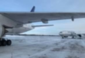 newark flight to hong kong marooned on frozen canadian tarmac for over 14 hours