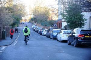 thousands of guildford parents asked to move on after parking illegally outside schools
