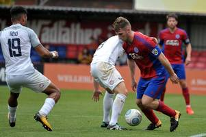 former ipswich town defender will miss the rest of aldershot town's season after surgery