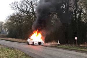 shocking video shows coach carrying school children drive past car on fire