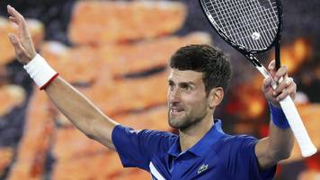 djokovic through after beating medvedev in four sets