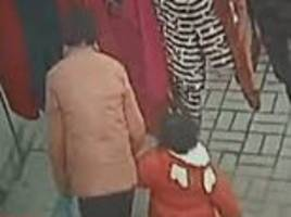 chilling moment human trafficker lures three-year-old girl with a toy before dragging her away