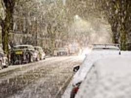 'Just seen a SNOWFLAKE!': Londoners hit the panic button as first signs of snow